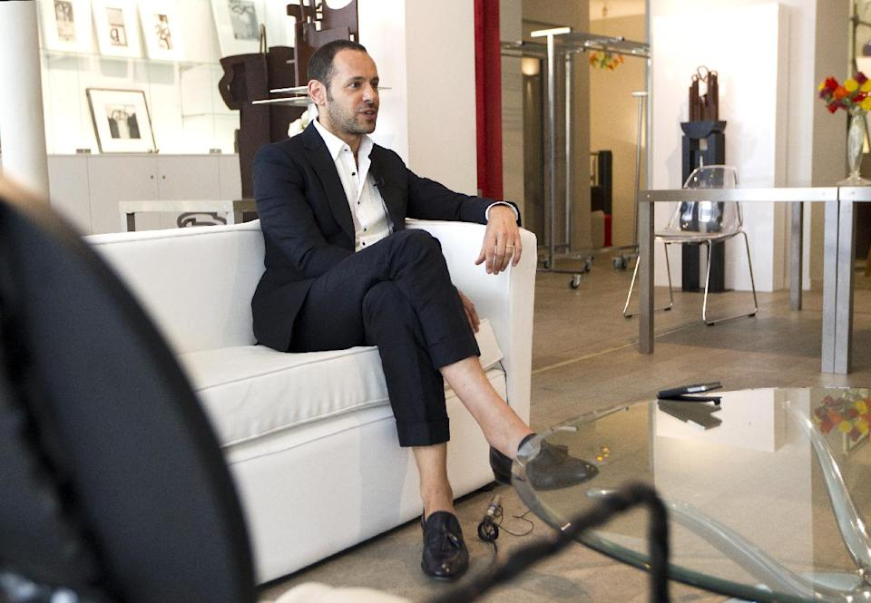 Salvatore Ferragamo's creative director, Massimiliano Giornetti, talks during an interview with the Associated Press, in Paris, Thursday, June 14, 2012. (AP Photo/Jacques Brinon)