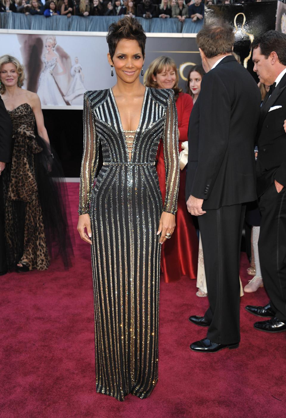 Actress Halle Berry arrives at the Oscars at the Dolby Theatre on Sunday Feb. 24, 2013, in Los Angeles. (Photo by John Shearer/Invision/AP)