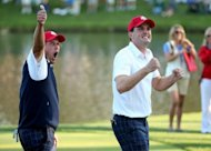 Phil Mickelson and Keegan Bradley of the USA celebrate on the 17th green after defeating the McIlroy/McDowell team 2&1 during the Afternoon Four-Ball Matches for The 39th Ryder Cup at Medinah Country Club, on September 28, in Medinah, Illinois