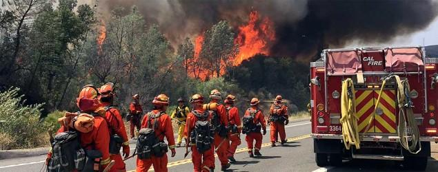 Massive Calif. wildfire jumps containment line