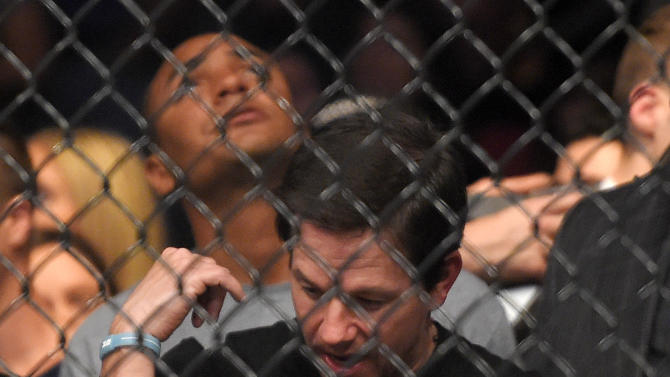 Actor Mark Wahlberg reacts as he watches a replay of the fight between Ronda Rousey  and Cat Zingano in a UFC 184 mixed martial arts bantamweight title bout, Saturday, Feb. 28, 2015, in Los Angeles. Rousey won after Zingano tapped out 14 seconds into the first round. (AP Photo/Mark J. Terrill)