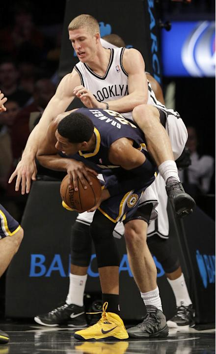 Brooklyn Nets' Mason Plumlee, top, and Indiana Pacers' Danny Granger vie for a rebound during the first half of an NBA basketball game Monday, Dec. 23, 2013 in New York