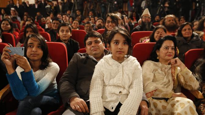 Attendees listen as U.S. President Obama delivers a speech at Siri Fort Auditorium in New Delhi