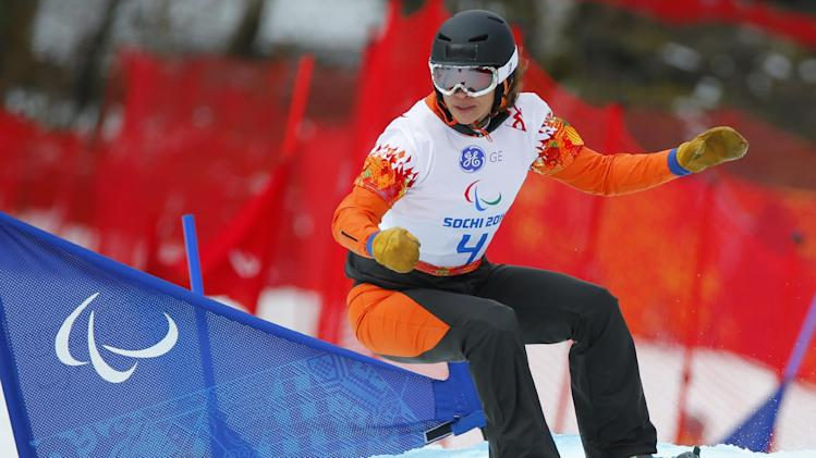 Bibian Mentel-Spee of Netherlands competes during women's para-snowboard cross, standing event at the 2014 Winter Paralympic, Friday, March 14, 2014, in Krasnaya Polyana, Russia. (AP Photo/Dmitry Lovetsky)