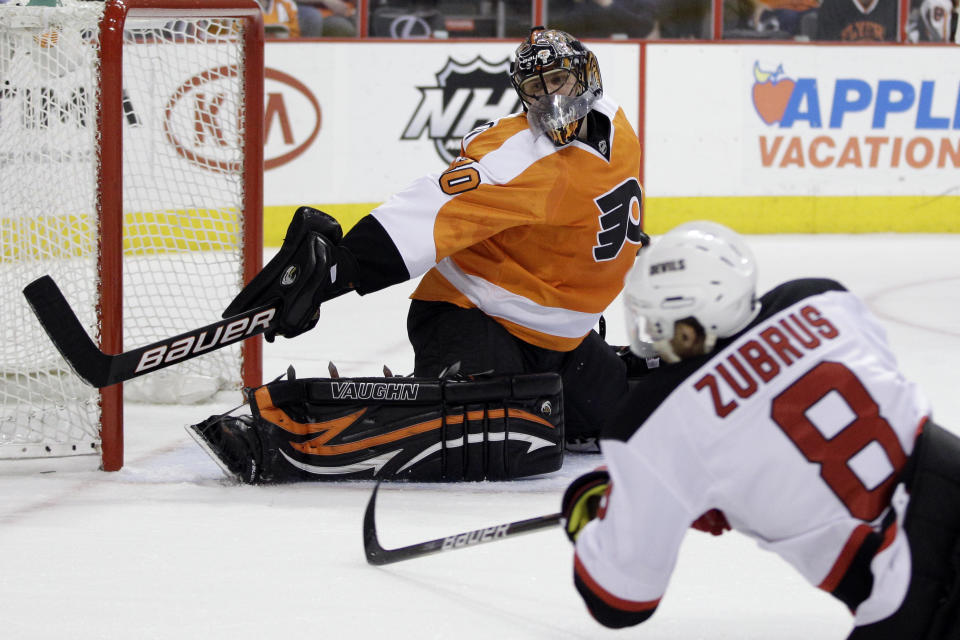 Philadelphia Flyers goalie Ilya Bryzgalov, of Russia, deflects a shot by New Jersey Devils' Dainius Zubrus (8), of Lithuania, during the first period of Game 5 of a second-round NHL hockey Stanley Cup playoff series, Tuesday, May 8, 2012, in Philadelphia. (AP Photo/Matt Slocum)