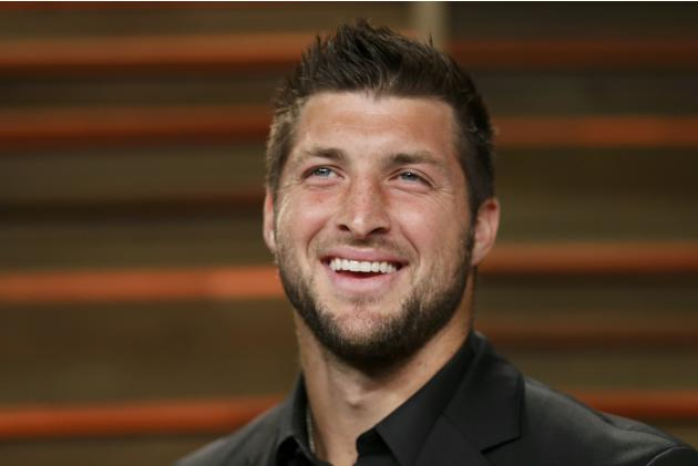 Former NFL player Tim Tebow arrives at the 2014 Vanity Fair Oscars Party in West Hollywood, California March 2, 2014. REUTERS/Danny Moloshok (UNITED STATES TAGS: ENTERTAINMENT SPORT FOOTBALL) (OSCARS-