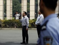 &lt;p&gt;A Chinese government official tries to calm protesters as they march down the street in Ningbo, east China&#39;s Zhejiang province on Sunday.&lt;/p&gt;