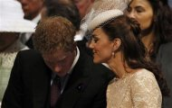 Catherine, Duchess of Cambridge speaks to Prince Harry during a thanksgiving service to mark the Queen&#39;s Diamond Jubilee at St Paul&#39;s Cathedral in London