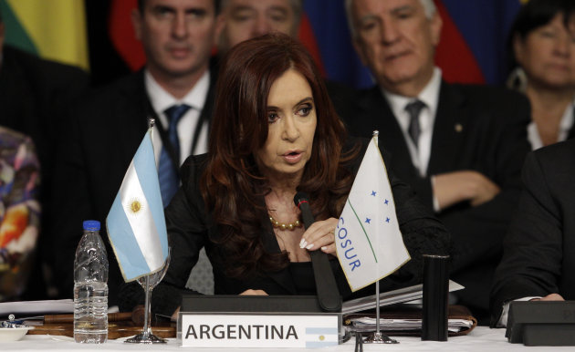 Argentina's President Cristina Fernandez, center, delivers a speech at the Mercosur summit in Mendoza, Argentina, Friday, June 29, 2012. Fernandez announced that the Mercosur trade bloc will not slap economic sanctions on Paraguay after the ousting of its president because they felt it would hurt the Paraguayan people. Mercosur leaders criticized the impeachment and barred President Fernando Lugo's replacement, former Vice President Federico Franco, from attending the summit. (AP Photo/Natacha Pisarenko)