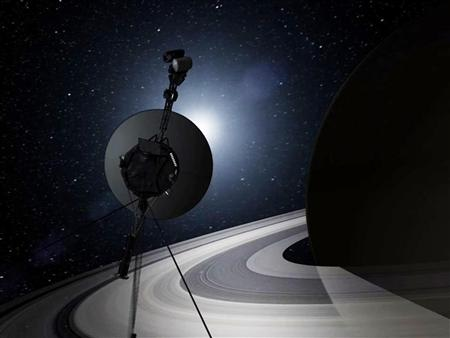 This artist's concept shows NASA's Voyager encountering Saturn on the twin spacecrafts tour of the solar system in this handout provided by NASA. REUTERS/NASA/JPL-Caltech
