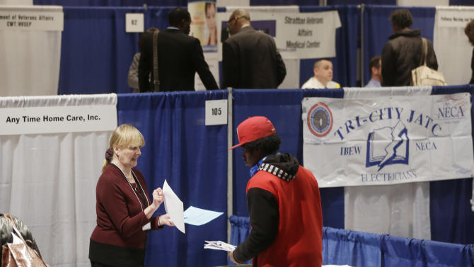 FILE - In this Thursday, April 11, 2013 file photo, Kathie Maiello of Any-Time Home Care, left, talks with Jashod Chaney, of Albany, at the Dr. King Career Fair at the Empire State Plaza Convention Center, in Albany, N.Y. Payroll processor ADP said Wednesday, June 5, 2013, that companies added 135,000 jobs in May. That's higher than April's revised total of 113,000. But it's much lower than the gains ADP reported over the winter, which averaged more than 200,000 a month from November through February. (AP Photo/Mike Groll, File)