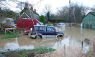 Melting Snow And Downpours Cause Flooding