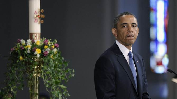 """President Barack Obama pauses while speaking at the """"Healing Our City: An Interfaith Service"""" at the Cathedral of the Holy Cross in Boston, Thursday, April 18, 2013. The service is dedicated to those who were gravely wounded or killed in Monday's bombing near the finish line of the Boston Marathon. (AP Photo/Susan Walsh)"""
