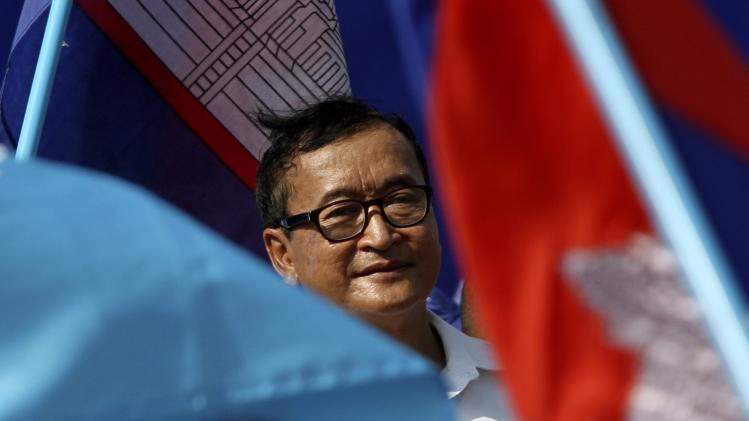 Leader of the opposition CNRP Rainsy smiles during a march to commemorate International Human Rights Day in Phnom Penh