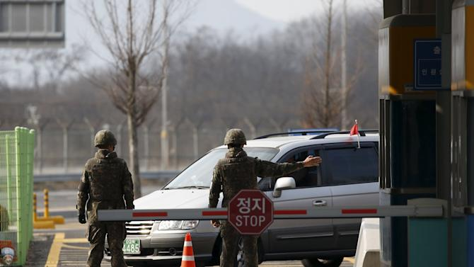 South Korean soldiers stand guard at a gateway which leads to the Kaesong Industrial Complex (KIC) at the South's CIQ, in Paju