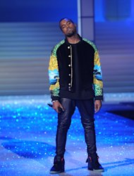 FILE - In this Nov. 9, 2011 file photo, Kanye West performs during the Victoria's Secret fashion show in New York. Kanye West is among the six nominees with a leading six nods for the 55th annual Grammy Awards, announced Wednesday night at Bridgestone Arena in Nashville, Tenn. (AP Photo/Brad Barket, File)