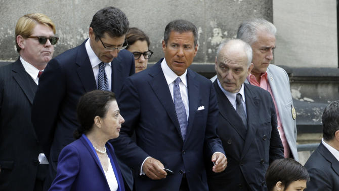 "HBO CEO Richard Plepler, center, and David Chase, center right, producer of ""The Sopranos"", walk out of Cathedral Church of Saint John the Divine after funeral services for actor James Gandolfini, Thursday, June 27, 2013, in New York. Gandolfini, who played Tony Soprano in the hit HBO show, died while vacationing in Italy last week. (AP Photo/Julio Cortez)"