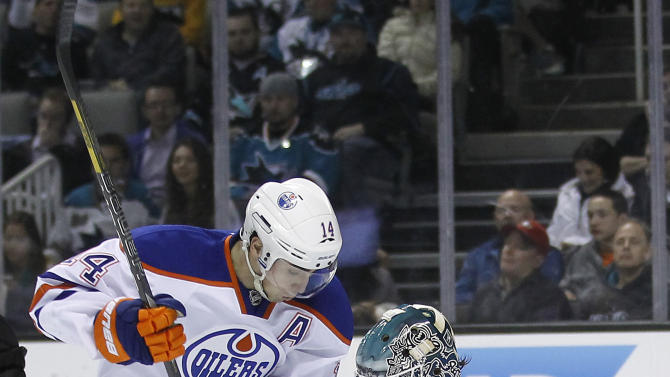 San Jose Sharks goalie Antti Niemi (31), of Finland, deflects a shot on goal by Edmonton Oilers center Jordan Eberle (14) during the second period of an NHL hockey game in San Jose, Calif., Thursday, Jan. 31, 2013. (AP Photo/Tony Avelar)