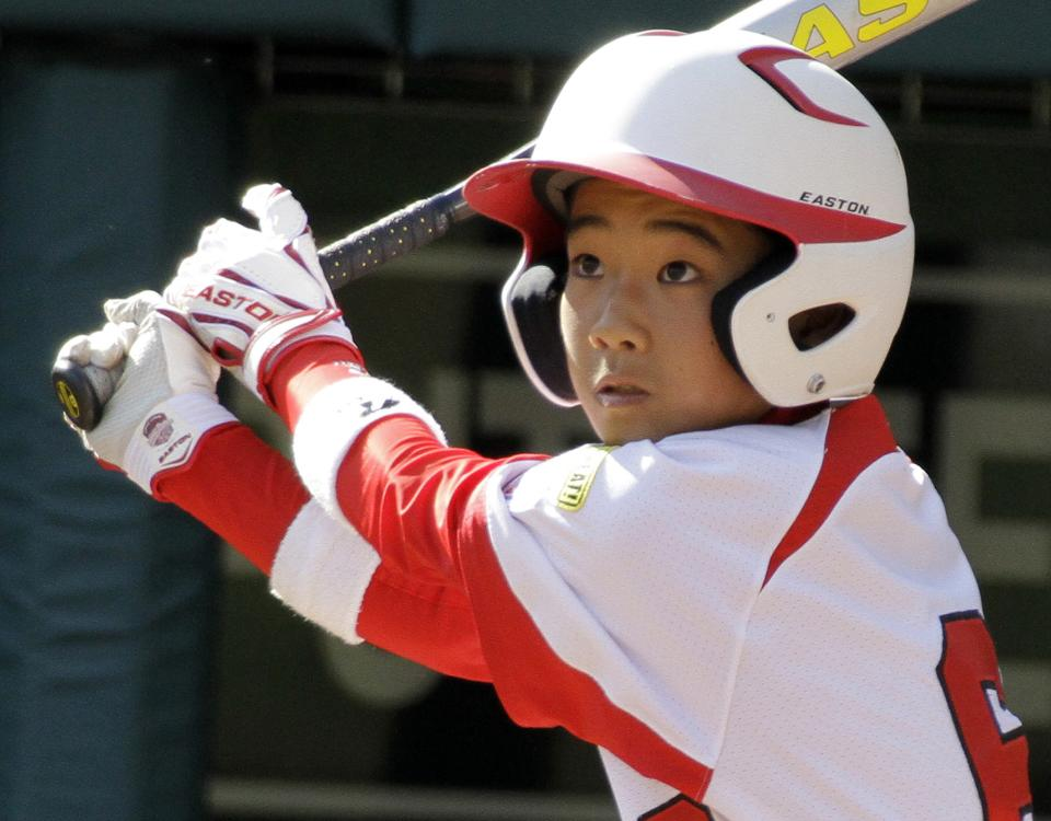 Hamamatsu City, Japan's, Ken Igeta hits an RBI double off Langley, British Columbia pitcher Cole Cantelon during the third inning of a baseball game at the Little League World Series in South Williamsport, Pa., Tuesday, Aug. 23, 2011. Japan won 4-0. (AP Photo/Gene J. Puskar)