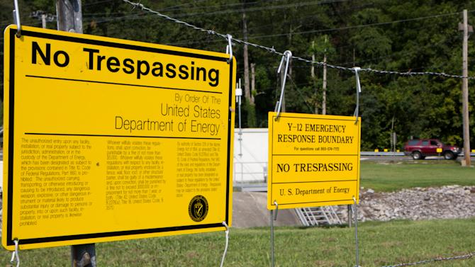 Signs warn against trespassing onto the  Y-12 National Security Complex in Oak Ridge, Tenn., on Friday, Aug. 17, 2012. The plant recently resumed operations put on hold after three anti-war protesters, including an 82-year-old nun, cut their way through three fences and spray-painted slogans on the wall of a weapons-grade uranium facility. (AP Photo/Erik Schelzig)