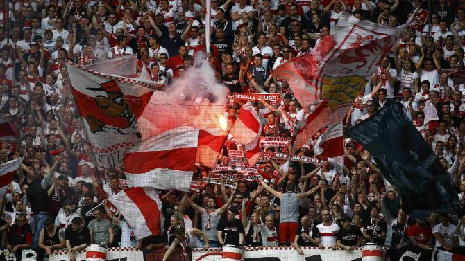 VFB Stuttgart supporters chant slogans before their German Bundesliga first division soccer match against SC Paderborn in Paderborn