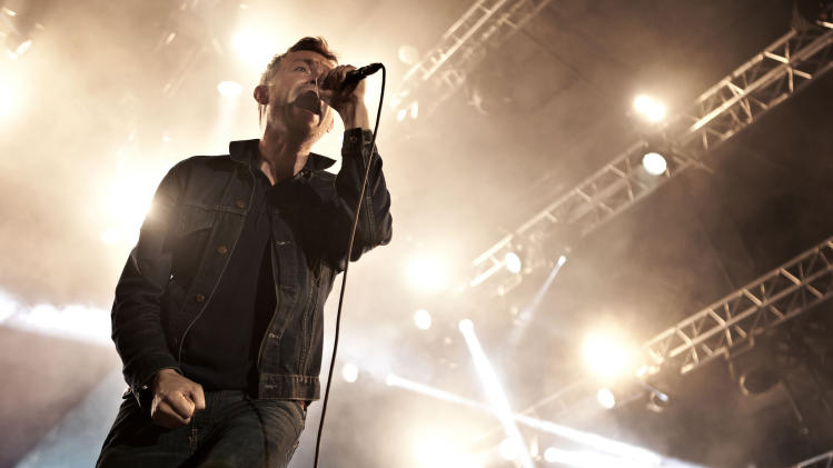 "Lead singer Damon Albarn from British rock band ""Blur,"" performs at the main stage of the Skanderborg Music Festival 2012 in Skanderborg, Denmark, Thursday evening Aug. 9. 2012. Blur will perform at the closing ceremony of the Olympics in London on Sunday. (AP Photo/Polfoto, Sisse Dupont) DENMARK OUT"