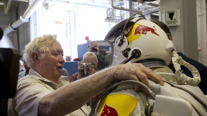 In this Nov. 8, 2011, photo provided by Red Bull Stratos, retired U.S Air Force Col. Joe Kittinger, left, and pilot Felix Baumgartner of Austria greet each other during the Brooks chamber test for Red Bull Stratos, a mission to the edge of space to break the speed of sound in freefall, in San Antonio. On Tuesday, Oct. 9, 2012, if winds allow, in the desert surrounding Roswell, N.M., pilot Felix Baumgartner will attempt to break Kittinger's world record for the highest and fastest free fall. (AP Photo/Red Bull Stratos, Christian Pondella)