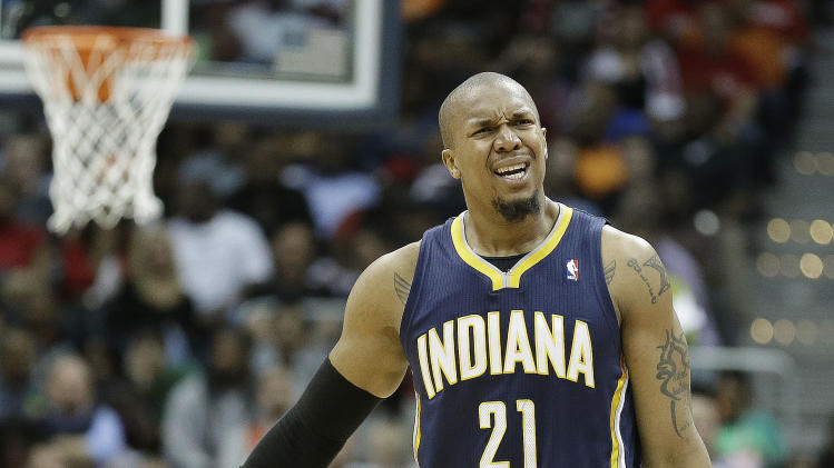 Indiana Pacers power forward David West (21) reacts to a foul against the Atlanta Hawks during the first half in Game 3 of their first-round NBA basketball playoff series, against the Indiana Pacers, Saturday, April 27, 2013 in Atlanta. (AP Photo/John Bazemore)
