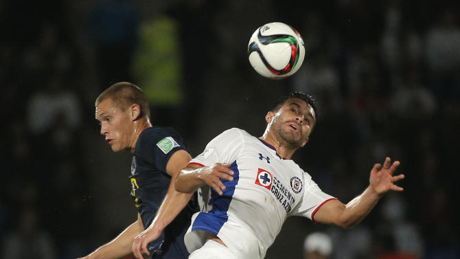 Auckland City FC's John Irving, left and Cruz Azul's Ismael Valadez jump for the ball during the 3rd place match between Cruz Azul and Auckland City FC, at the Club World Cup soccer tournament in Marrakech, Morocco, Saturday, Dec. 20, 2014. (AP Photo/Christophe Ena)
