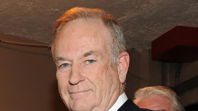 "FILE - This Oct. 13, 2012 file photo shows Fox News commentator and author Bill O'Reilly at the Comedy Central ""Night Of Too Many Stars: America Comes Together For Autism Programs"" at the Beacon Theatre in New York. Following several stories questioning Bill O'Reilly's past reporting, a liberal media watchdog has ordered its researchers to comb through years of the Fox News Channel host's writings, radio and television shows and public appearances to find examples of inconsistencies. O'Reilly is squarely in the crosshairs of Media Matters for America, an illustration of how the media is subject to the same political campaigns as politicians.  (Photo by Frank Micelotta/Invsion/AP, File)"