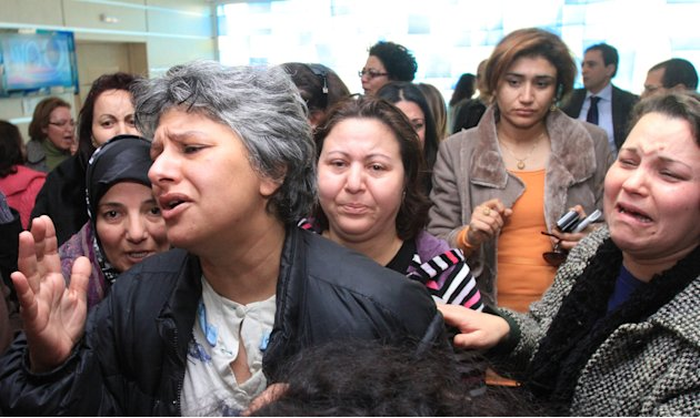 Besma Khlifi, left, wife of Tunisian opposition leader Chokri Belaid, reacts after he was shot to death in Tunis, Wednesday, Feb. 6, 2013.  A critic of the Islamist-led government and violence by radi