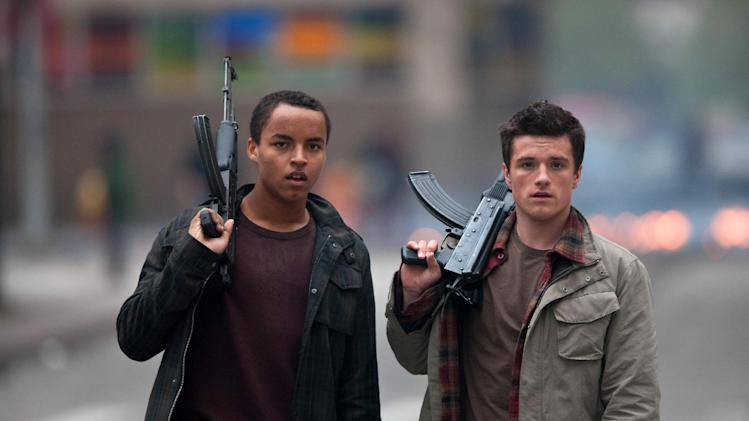 "This film image released by Film District shows Connor Cruise, left, and Josh Hutcherson in a scene from ""Red Dawn."" (AP Photo/Film District, Mark Preston)"
