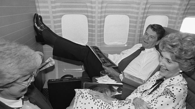 FILE - In this July 19, 1980 file photo taken byWalt Zeboski, Republican presidential nominee Ronald Reagan props his feet up as wife Nancy, foreground, talks with unidentified woman aboard an airplane, in Los Angeles, bringing the Reagan's back home to California from a brief stopover in Texas. Former Associated Press photographer Walt Zeboski, who chronicled California politics for 30 years and Ronald Reagan's 1980 presidential campaign, died at age 83 Monday. (AP Photo/Walt Zeboski, File)