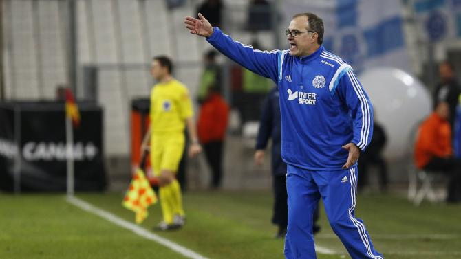 Olympique Marseille's Coach Marcelo Bielsa reacts during the French Ligue 1 soccer match against Evian Thonon Gaillard at the Velodrome Stadium in Marseille
