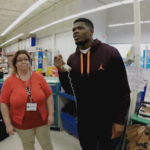 NFL Rush: Houston Texans wide receiver Andre Johnson treats kids to toys