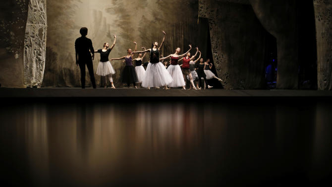 "In this photo made Tuesday, Feb. 5, 2013, Bolshoi dancers hold a rehearsal of the ballet Giselle in the Bolshoi Theater in Moscow, Russia. Pavel Dmitrichenko, a Russian ballet star who most recently played the title role in ""Ivan the Terrible"" at the famed Bolshoi Theater has confessed that he organized the acid attack on the theater's ballet chief, Sergei Filin, Moscow police said Wednesday March 6, 2013.  (AP Photo/Alexander Zemlianichenko)"