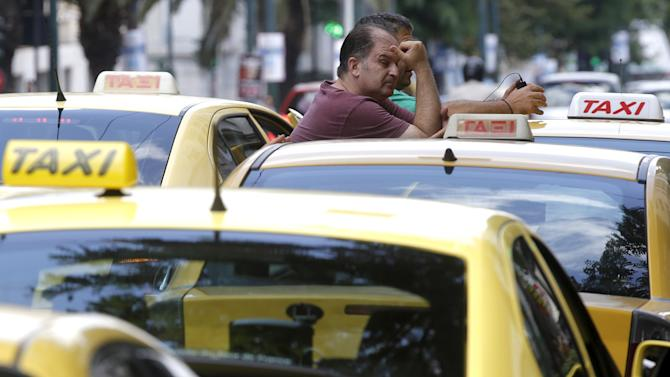 Taxi drivers wait for clients in central Athens