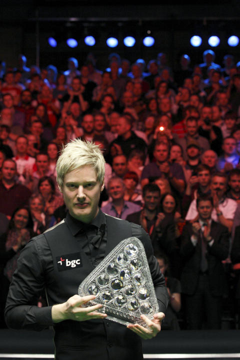 Australia's Neil Roberts poses with the Masters trophy after winning over England's Shaun Murphy in the BGC Masters snooker final at Alexandra Palace in London on January 22, 2012. Australia's 2010 wo