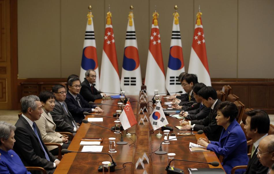 South Korean President Park talks with Singapore's PM Lee during their meeting at the presidential Blue House in Seoul