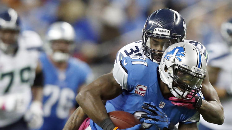 Detroit Lions wide receiver Calvin Johnson (81) makes a reception against Seattle Seahawks cornerback Brandon Browner (39) in the second half of an NFL football game, Sunday, Oct. 28, 2012. in Detroit. (AP Photo/Rick Osentoski)