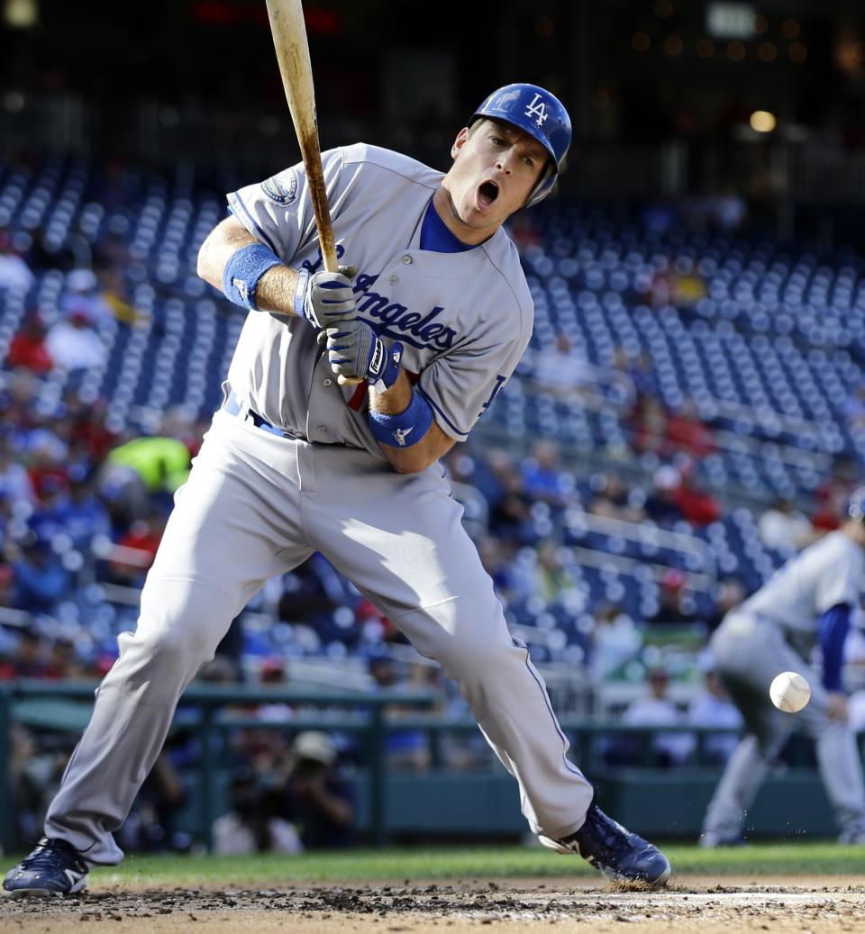 Los Angeles Dodgers' A.J. Ellis reacts as he is hit by a pitch during the second inning of the first baseball game of a doubleheader against the Washington Nationals at Nationals Park Wednesday, Sept. 19, 2012, in Washington. (AP Photo/Alex Brandon)