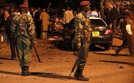 Kenyan police secure the scene of an explosion outside the Pangani police station in the capital Nairobi