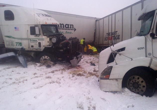 This photo provided by the Iowa State Patrol shows the scene of a 25-vehicle pileup that killed three people Thursday, Dec. 20, 2012 north of Des Moines, Iowa.  Authorities said drivers were blinded b