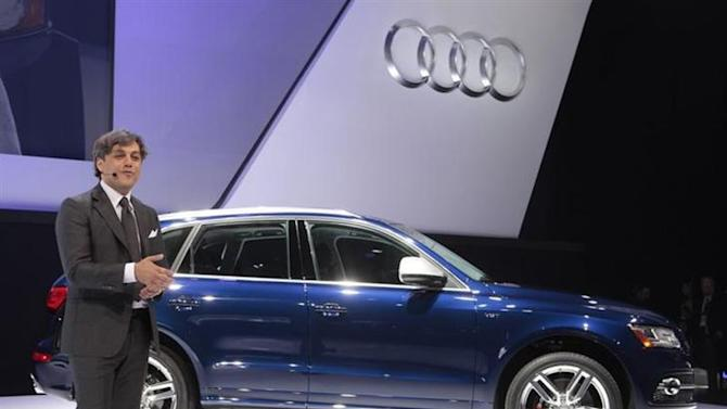 Luca de Meo, Audi member of Board of Management, speaks next to the Q5S crossover at the North American International Auto Show in Detroit, Michigan January 14, 2013. REUTERS/Rebecca Cook/Files
