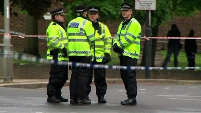 Police search homes after British soldier's murder