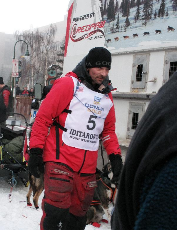 Four-time champion Lance Mackey prepares to take part in the ceremonial start of the Iditarod Trail Sled Dog Race Saturday, March 2, 2013, in Anchorage, Alaska. The competitive portion of the 1,000-mile race is scheduled to begin Sunday in Willow, 50 miles to the north. (AP Photo/Rachel D'Oro)