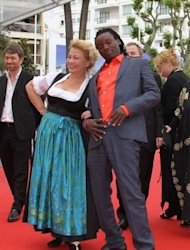 "Actress Margarethe Tiesl and actor Peter Kazungu dance on the red carpet as they arrive for the screening of ""Paradies: Liebe"" (Paradise: Love) at the Cannes Film Festival on May 18. The graphic, unflinching look at the interplay of desire, money and power among European women sex tourists and African gigolos hit the Cannes screen Friday"