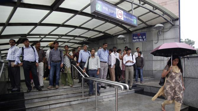 Indian commuters exit an underground metro station where services were fully restored after Tuesday's power outage in New Delhi, India, Wednesday, Aug. 1, 2012. Factories and workshops across India were up and running again Wednesday, a day after a major system collapse led to a second day of power outages and the worst blackout in history. An estimated 620 million people were left without electricity after India's northern, eastern and northeastern grids cascaded into failure Tuesday afternoon. (AP Photo/Rajesh Kumar Singh)