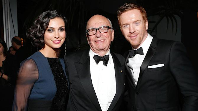 IMAGE DISTRIBUTED FOR FOX SEARCHLIGHT - From left, actress Morena Baccarin, Rupert Murdoch, and actor Damian Lewis attend the Fox Golden Globes Party on Sunday, January 13, 2013, in Beverly Hills, Calif. (Photo by Todd Williamson/Invision for Fox Searchlight/AP Images)