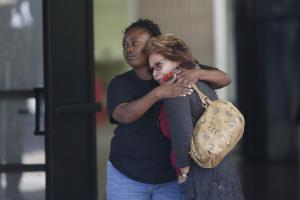 Two women embrace at a community center where family …